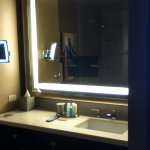 Awesome lighted magnifying mirror and built in TV in bathroom mirror