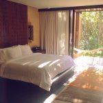 Two Bedroom Pool Villa - Master Bedroom with two sliding door walls that open to pool and patio