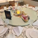 our family dining table setting with large lazy susan