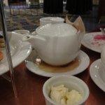 Tea leaking from broken teapot