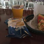 chips and a tuppermans pale ale and a slice of watermelon