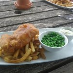 fish and chips with garden peas in the outdoor garden