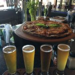 This is an IPA Flight, and an Eggplant Marino pie. Very good. A bit pricey. The pie is $18.49 pl