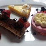Dessert trio: Chocolate Hazelnut cake, Lemon Tart and Raspberry Macaron.