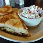 A thin Cubano Melt with hot pickles and dry, onion flavored coleslaw.