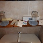 Vanity sink (basin) and guest complimentary offerings.