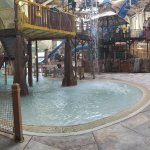 """A panorama view of the water park, standing near the """"Bear Essentials"""" gift shop."""