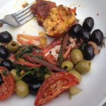 Falafel , rainbow chard , olives, tomatoes , lovely fresh bread. beautiful dressing , hint of mi