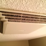 The bathroom fan -- clogged with dust