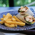 Our Chicken Breast wrap coated in Sweet chili sauce served with chips.