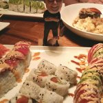 Li'l Butch eyes his Yosef, Burning Man & spicy tuna rolls!