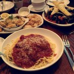 Spaghetti with Italian sausage and traditional marinara, muscles, calamari and stuffed mushrooms