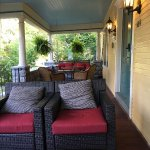 Comfy seating on the front porch, also with hanging swings.