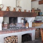 """""""Mantle piece display"""" and open fire (winter use) - in restaurant."""