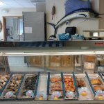 The inside of their store. Portions are all cut fresh. Fish are fileted and prepared on-site