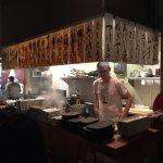 Yakitori grill bar in back.