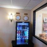 the vending machine below the clocks