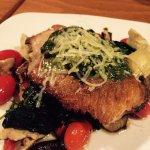 Seared Salmon over portobello mushrooms, spinach, artichokes and roasted tomato, with pesto sauc