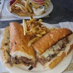 Philly cheese steak with fresh cut fries... and a 1/2 lb burger run thru the garden also with fr