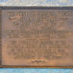 "Plaque on flight line at beginning of ""runway"""