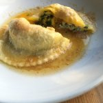 spinach raviolo with egg cooked inside