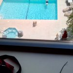 My husband relaxing by himself in the pool. This picture was taken from the fifth floor with a k