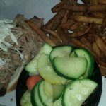 Pulled Pork and Brisket sandwich with Fries and Summer Squash