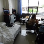 Room 10 has two beds, tv, cable, free wifi, a desk, a small couch, table and wardrobde