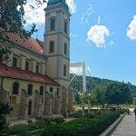 Budapest - Belvarosi Plebania Templom - church with Elizabeth bridge in the background