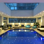 Indoor pool with outdoor access to sitting area