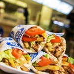 Chicken Gyros: chicken meat, dionysos sauce, fried potatoes, tomatoes, lettuce, greek pita.