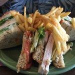 Delicious turkey club sandwich on rye.