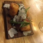 The tots covered in black truffles