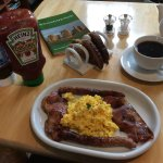 Scrambled eggs, local pork sausages and bacon