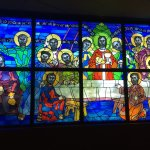 Stain glass window to the left of the Altar.
