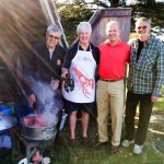 Volunteers cooking lobsters outside the Acadian Oven - annual lobster supper at Fort Point Museu