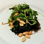 Grilled Octopus with white beans, kale, crispy prosciutto, and preserved lemon vinaigrette.