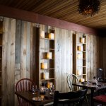 Walls throughout the restaurant feature wood paneling harvested from the bottom of the Penobscot