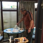 My husband pouring my tea in our conservatory following delivery of breakfast