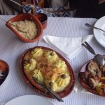 bacalhau e cabrito ao forno, bela salada, arroz
