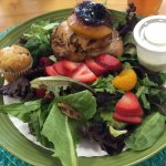 Southern Belle Salad with Grilled chicken stuffed with cornbread and topped with a baked peach