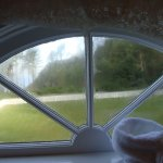 View and Bathroom window above antique tub