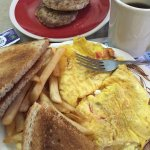 Tomato, onion and feta cheese omelette with sausage patties.