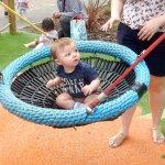 Noah on a novel swing