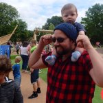 Noah on his dad's shoulders in the play area