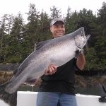 Happy client with a big king salmon.