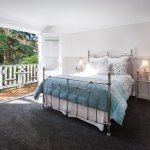 Stables Cottage - Main bedroom with double French doors, Queen bed and electric blankets