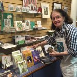 Gift store manager Judy Evans working on author book display
