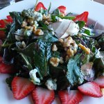SWEET KALE Artisan kale, spinach, fresh coconut shavings, strawberries, walnuts and crumbled blu