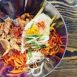 The delicious and fresh bibimbap mixed rice bowl with chicken.